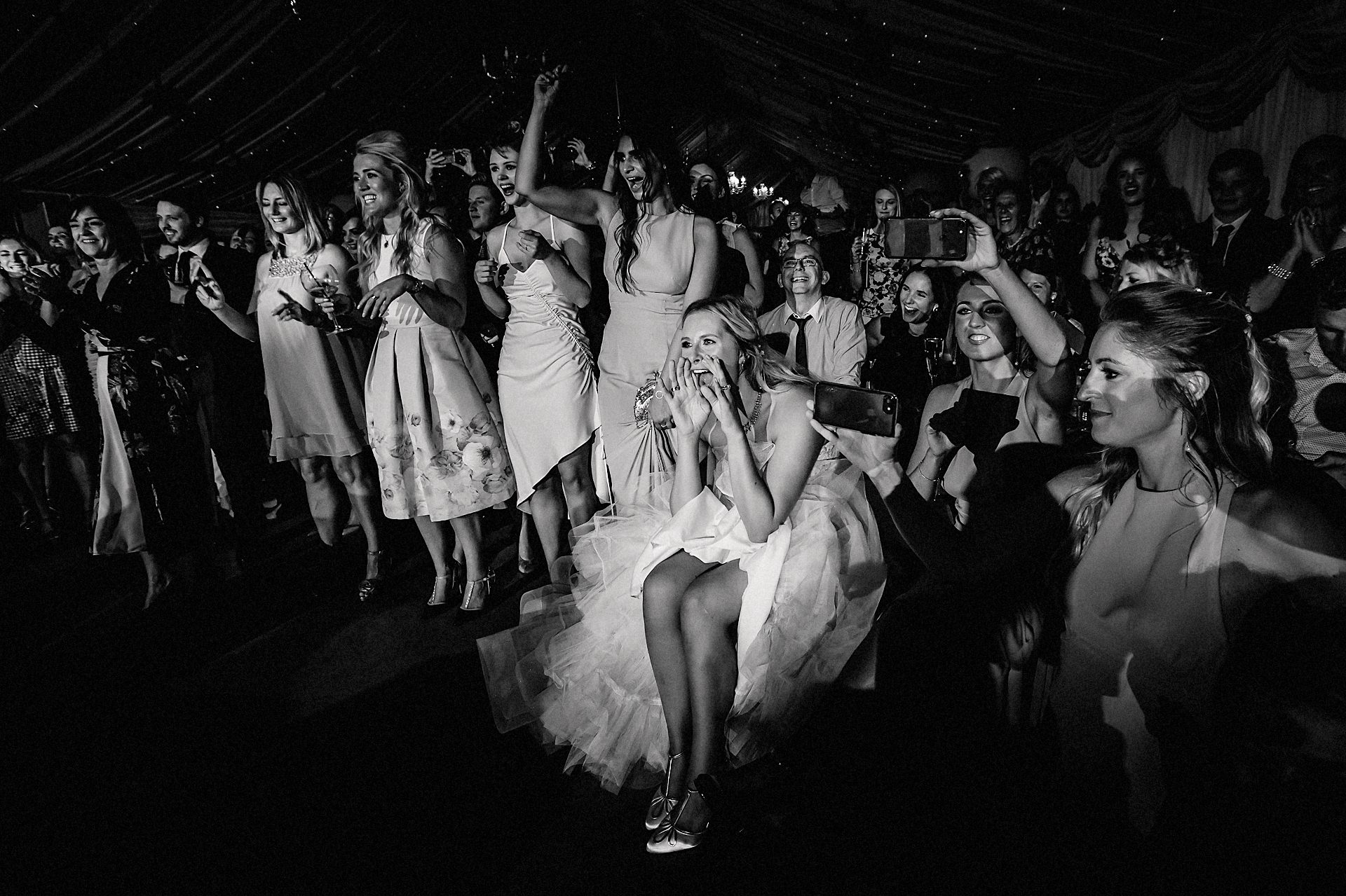 bride cheering on the groom