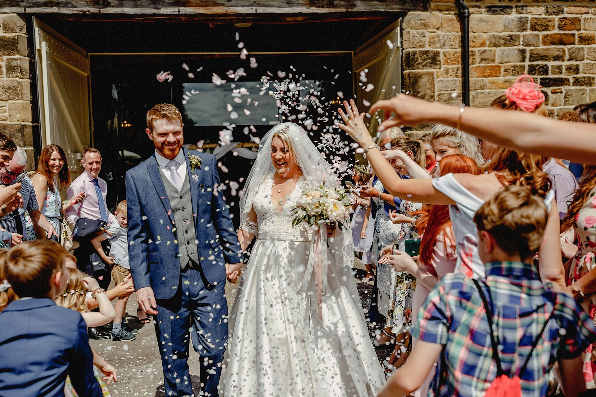 throwing confetti over the married couple